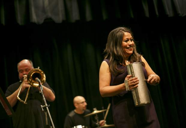 Salsa Band Remezcla's Magally Luna plays with a Guira during the First Friday celebrating the latino community, Feb. 1, at the Silverthorne Pavilion.