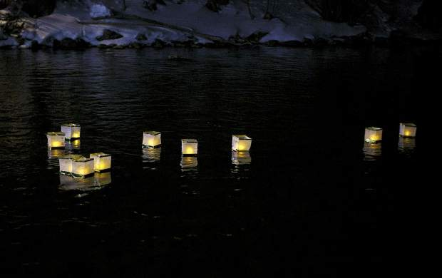 Lanterns float down the Blue River as part of the Noche De Candela during First Friday, Feb. 1, in Silverthorne.