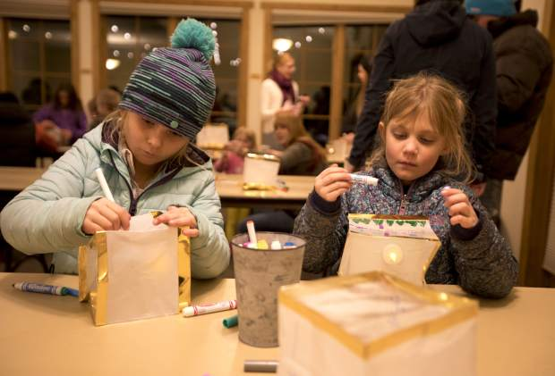 Teresa Cerny, 6, and Kate Munchoff, 6, decorate the lanterns during the First Friday celebrating the latino community, Feb. 1, at the Silverthorne Pavilion.