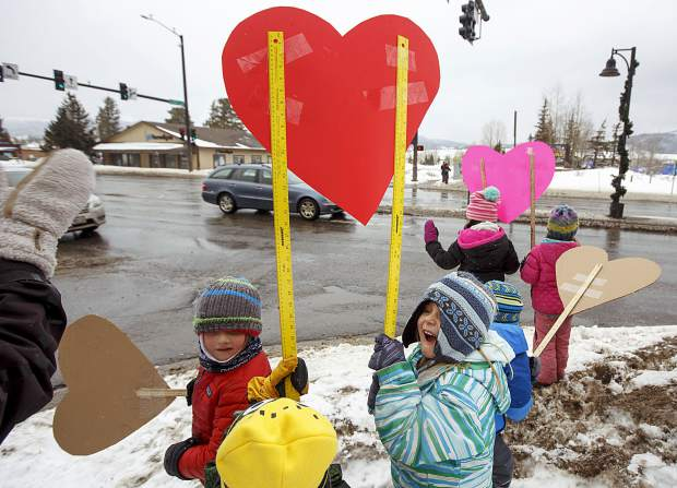 Frisco Elementary School kindergarten student, Kyla Hausler, at right, reacts after a passing motorist honked along Highway 9 Thursday, Feb. 14, in Frisco.