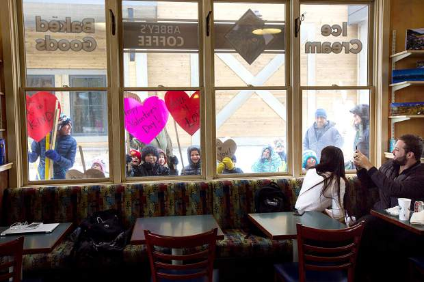 Frisco Elementary School kindergarten students spread love to Abbey's Coffee as they walk past Thursday, Feb. 14, in Frisco.