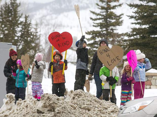 Frisco Elementary School kindergarten students spread love for passing motorists along Highway 9 Thursday, Feb. 14, in Frisco.