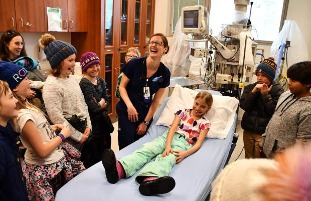 St. Anthony Summit Medical Center Emergency Department nurse Ruth Nash spent part of her Thursday afternoon talking to Frisco Elementary School fifth-graders about the how the hospital and its caregiver take care of the sick and injured. It wasn't all serious - there were plenty of opportunities for laughs, too. The school's fifth-graders are learning about the human body and made handmade Valentine's Day cards for St. Anthony Summit staff and patients.