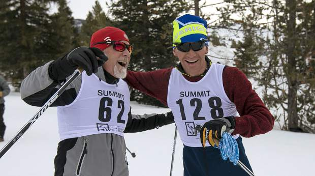 Race participants greet each other at the finish line during the 49th Annual Frisco Gold Rush Saturday, Feb. 9, on the Frisco Peninsula.
