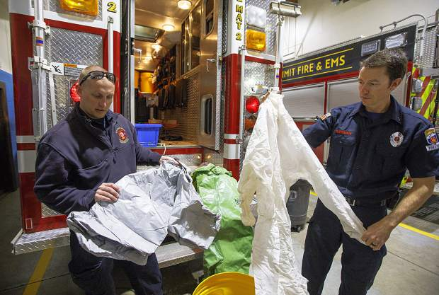 Red, White, and Blue Fire Department Battalion Chief Ryan Roberts, left, and Summit Fire & EMS Lieutenant Aaron Kaltenbach bring out equipment used for hazardous material emergency situations Wednesday, Feb. 6, at Station 2 in Frisco.