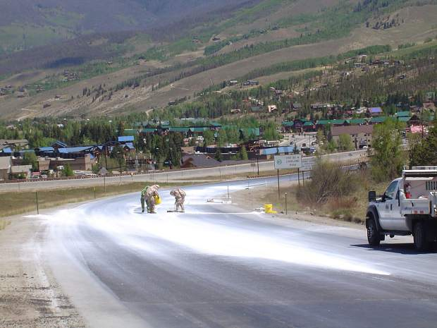 A significant quantity of lime powder spilled onto Interstate 70 on May 30, 2012, prompting firefighters to don protective gear to mitigate the hazard created by the caustic substance.