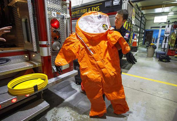 Summit Fire & EMS Lieutenant Aaron Kaltenbach holds the level A suit Wednesday, Feb. 6, at Station 2 in Frisco, used by firefighters in hazardous materials emergency situations.