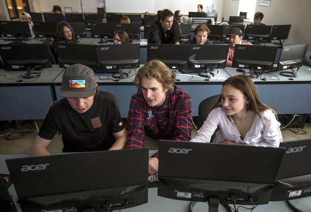 Summit High School juniors, from left, Timmy Lunney, Tim Gallagher, and Camden Gallen designing a game in their computer science principles class Thursday, Jan. 31, in Breckenridge.