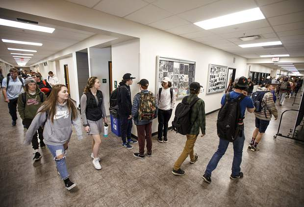 Summit High School students walk between classes Thursday, Jan. 31, in Breckenridge.