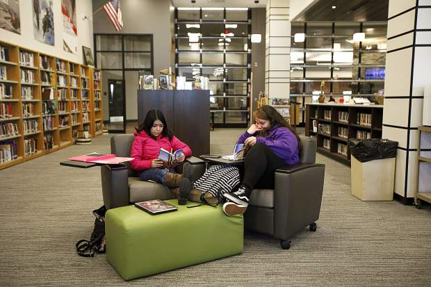 Summit High School seniors Elisabet Jasso, left, and Jennifer Amador study at the Summit High library, Thursday, Jan. 31, at the school in Breckenridge.