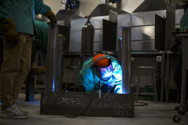 Summit High School senior Kevin Essary welds a table during welding class Thursday, Jan. 31, in Breckenridge.