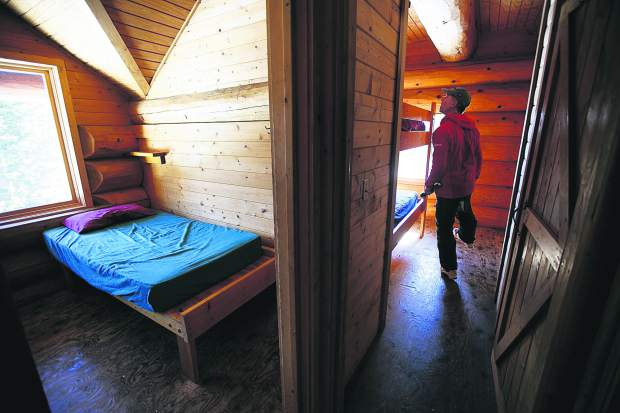 Summit Huts Association hutmaster Steve Huyler checks the bunkbeds inside Francie's Cabin for cleaning on Tuesday, Feb. 5, near Blue River.