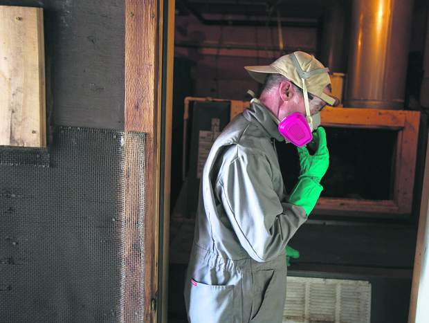 Summit Huts Association hutmaster Steve Huyler dons a suit to complete composting beneath the toilets at Francie's Cabin on Tuesday, Feb. 5, near Blue River.