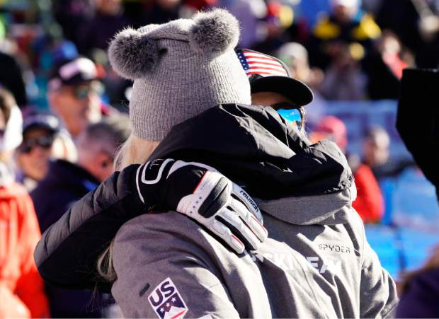 Lindsey Vonn, left, hugs Michaela Shiffrin in the finish area of an alpine sk, women's World Cup super-G event in Cortina D'Ampezzo, Italy on Sunday.