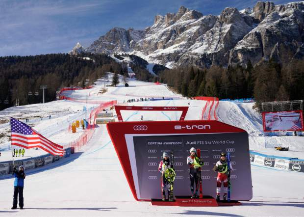 Mikaela Shiffrin, center, winner of an alpine ski, women's World Cup super-G, poses on the podium with second placed Liechtenstein's Tina Weirather, left, and third placed Austria's Tamara Tippler, in Cortina D'Ampezzo, Italy, Sunday, Jan. 20, 2019.