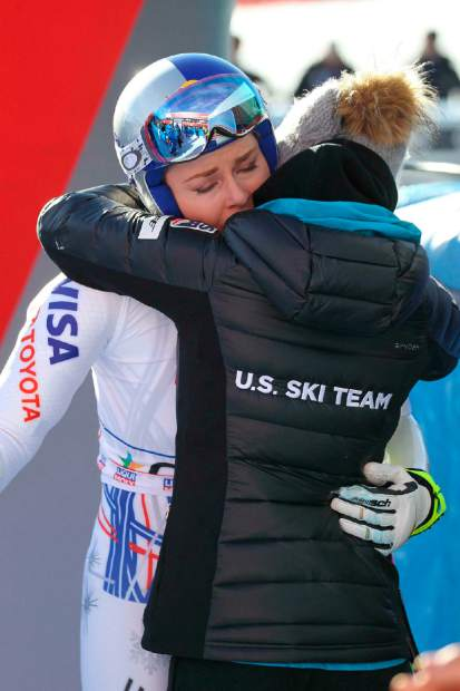 Lindsey Vonn hugs a U.S. team staffer in the finish area of an alpine ski women's World Cup super-G event in Cortina D'Ampezzo, Italy on Sunday.