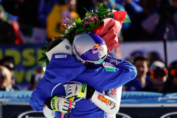 Lindsey Vonn hugs Italy's Sofia Goggia after completing an alpine ski, women's World Cup super-G in Cortina D'Ampezzo, Italy, Sunday, Jan. 20, 2019.