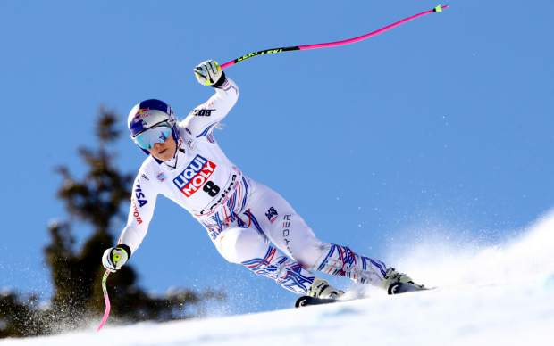 Lindsey Vonn speeds down the course during an alpine ski, women's World Cup super-G in Cortina D'Ampezzo, Italy, Sunday, Jan. 20, 2019.
