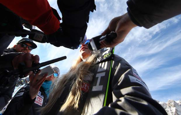 Lindsey Vonn answers reporters' questions in the finish area after completing an alpine ski, women's World Cup super-G in Cortina D'Ampezzo, Italy, Sunday, Jan. 20, 2019.