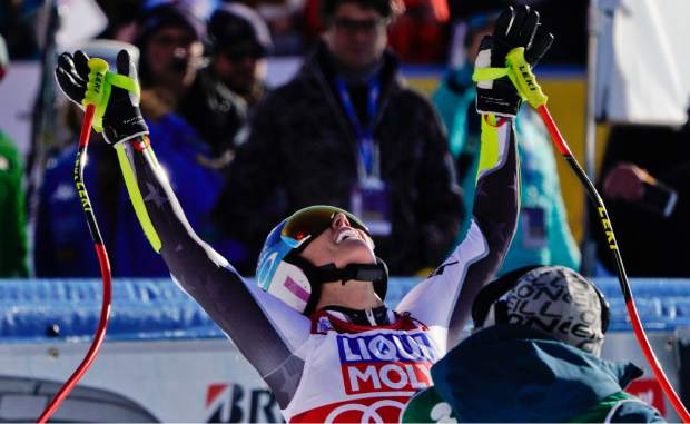 Mikaela Shiffrin celebrates after completing an alpine ski, women's World Cup super-G in Cortina D'Ampezzo, Italy, Sunday, Jan. 20, 2019.