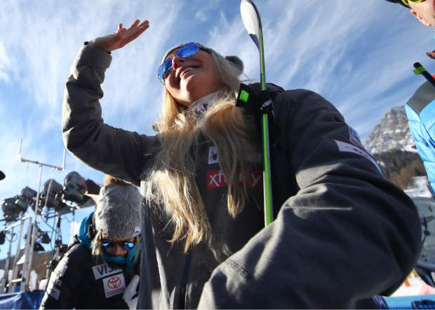 Lindsey Vonn waves as she stands in the finish area after completing an alpine ski women's World Cup super-G event in Cortina D'Ampezzo, Italy on Sunday.