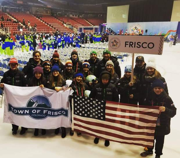 Team Frisco athletes and coaches pose for a photo at the site of the 1980 Miracle On Ice, the Lake Placid Olympic Center, after the openign ceremony of this year's International Children's Games.