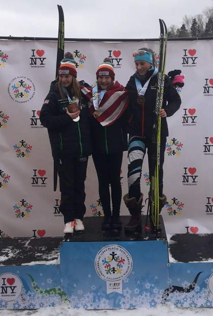 Team Frisco on Tuesday took gold and silver in the Nordic girls classic distance ski race at the Lake Placid, New York International Children's Games. Pictured at left is silver-medal winner Annabelle Pattenden while gold-medal winner Nina Schamberger is center.