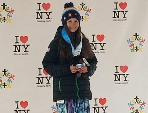 Team Frisco athlete Alex Thisted stands alone atop the podium after winning snowboard slopestyle gold at this week's International Children's Games in Lake Placid, New York.