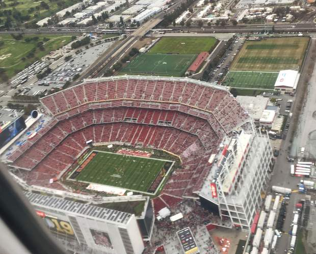 Less than an hour and a half before the start of the College Football Playoff national championship game, I snapped this photo from my plane seat of the venue for the game, Levi's Stadium. It was a race to make it there for kickoff.
