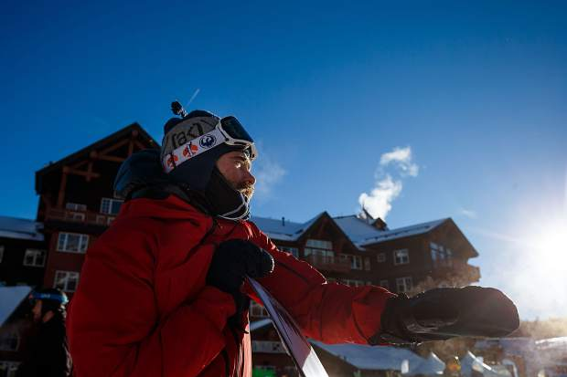 Professional snowboarder Danny Davis looks out at Peak 8 terrain while recreationally riding at Breckenridge Ski Resort during the Dew Tour on Dec. 14, 2018 in Breckenridge.