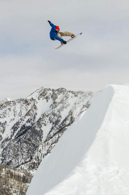 Multi-time X Games Aspen gold medalist Danny Davis executes an air to fakie on snow at Copper Mountain Resort last week, with the TenMile Range in view in the distance.