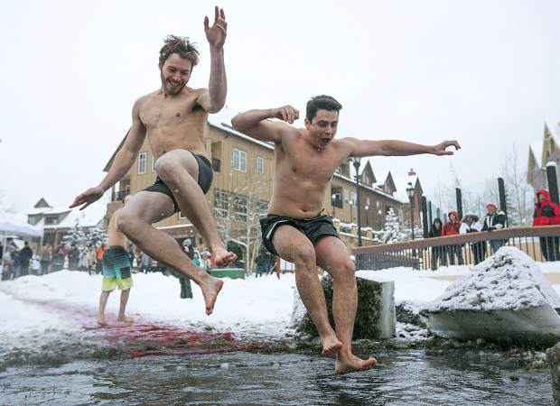 People jump into Maggie's Pond in part of Ullr Ice Plunge event Friday, Jan. 11, in Breckenridge.