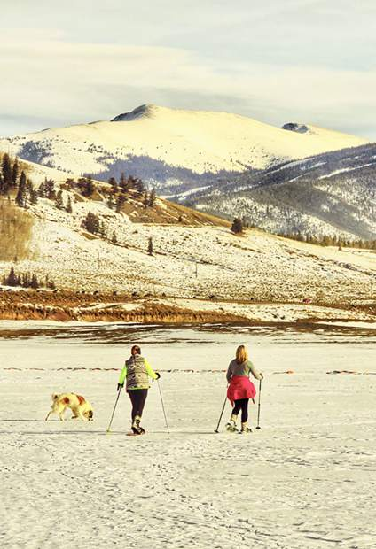 People snowshoe across Lake Dillon on Wednesday afternoon with Independence Mountain in background.