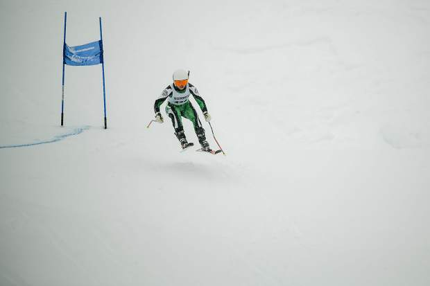 A Summit High School Alpine skier catches some air during Thursday's giant slalom state championship competition at Purgatory Resort in Durango.