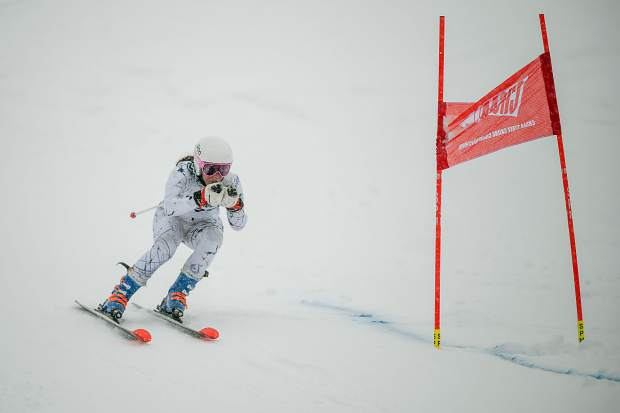 Summit High School Alpine skier Jenna Sheldon tucks her poles on a turn around a gate during Thursday's Colorado High School Ski League state-championship giant slalom competition at Purgatory Resort in Durango. The freshman Sheldon finished in 10th place, best of any Tiger in the competition.