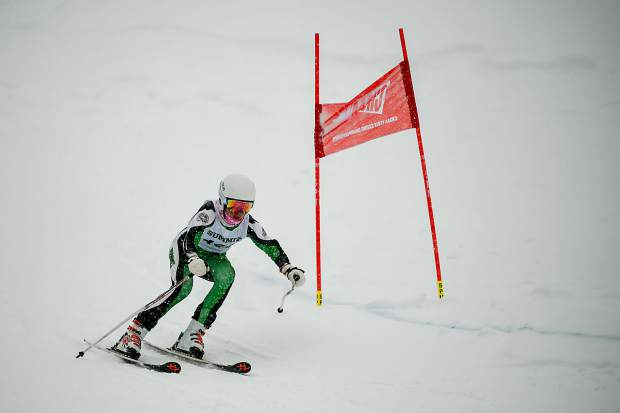 A Summit High School Alpine skier carves in the powder at Purgatory Resort during Thursday's Colorado High School Ski League state-championship giant slalom competition in Durango.