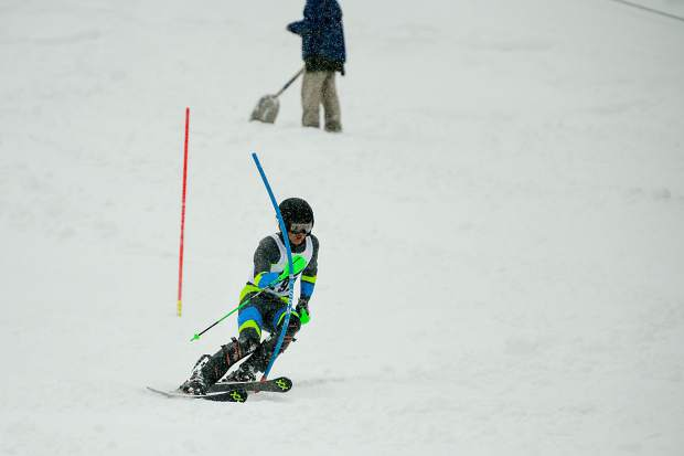 A Summit High School Alpine skier carves a turn during Friday's Colorado High School Ski League slalom state championship competition at Purgatory Resort in Durango.