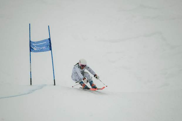 Summit High School Alpine skier Jenna Sheldon tucks on a turn around a gate during Thursday's Colorado High School Ski League state-championship giant slalom competition at Purgatory Resort in Durango. The freshman Sheldon led the Tigers, finishing in 10th place in the competition.