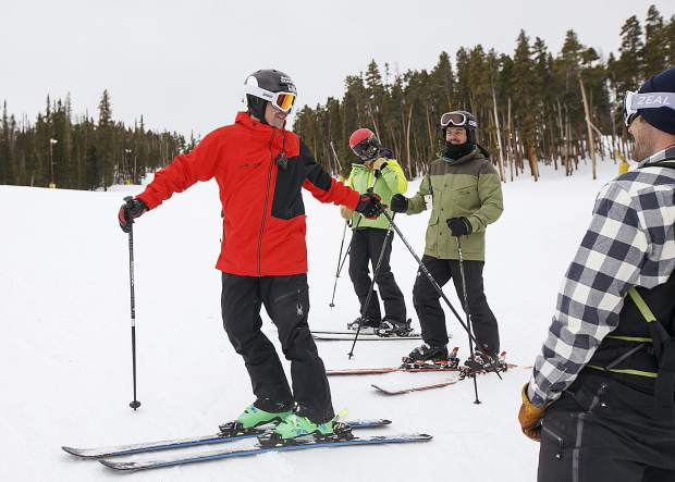 Jon Lujan, in red, a retired U.S. Marine Corps sergeant and 2014 Paralympian, skis with Keystone Adaptive Center clinic volunteers and participants as part of the Semper Fi Fund's adaptive military veterans clinic on Wednesday, Feb. 13, at Keystone Resort.