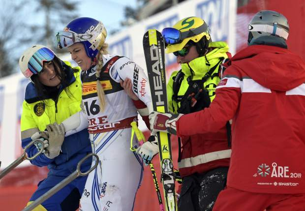 Lindsey Vonn is assisted after crashing during the women's super G at the alpine ski World Championships, in Are, Sweden on Tuesday.