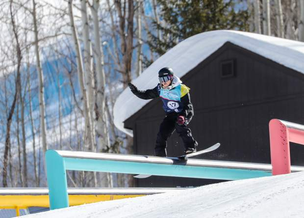 Enni Rukajarvi of Finland boardslides the second rail section of the slopestyle course during the women's semifnal round at the Burton US Open Snowboarding Championshipson Wednesday in Vail.