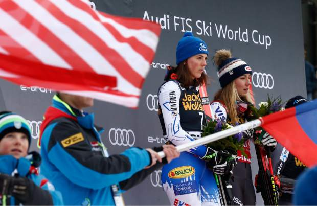 Mikaela Shiffrin, right, and Slovakia's Petra Vlhova, left, both winners of an alpine ski women's World Cup giant slalom event, celebrate on the podium in Maribor, Slovenia on Friday.