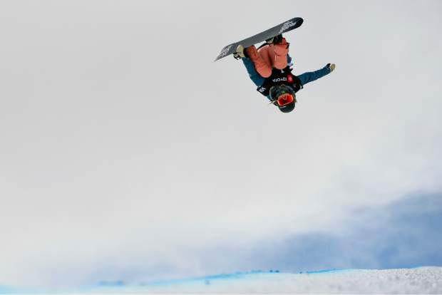 Chloe Kim, of the United States performs a trick during the women's snowboard halfpipe final at the freestyle ski and snowboard world championships on Friday in Park City, Utah.