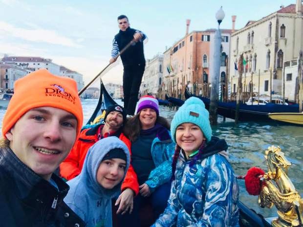 The Vaille family of Summit Cove, from left Jeremiah, Miles, Troy, Kendal and Lexi, pose for a photograph while riding in a gondola in Venice, one of the many tourist spots where Jeremiah made it a point to train for the World Snowshoe Championships despite the tourist element of the locations.