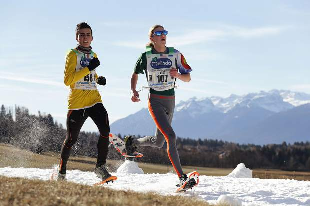 Summit County snowshoer Jeremiah Vaille, right, races in Fondo, Italy at the 2019 World Snowshoe Junior Championships, which the 16 year old won by a 10-second margin.