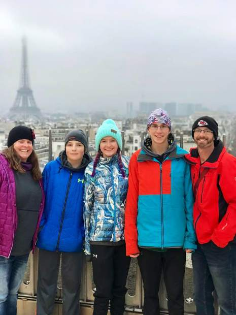 The Vaille family of Summit Cove, from left Kendal, Miles, Lexi, Jeremiah and Troy, pose for a photograph in front of the Eiffel Tower in Paris, one of the many tourist spots where Jeremiah made it a point to train before the World Snowshoe Championships despite the tourist element of the locations.