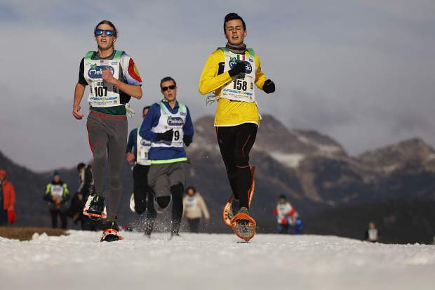 Summit County snowshoer Jeremiah Vaille, left, races in Fondo, Italy at the 2019 World Snowshoe Junior Championships, which the 16 year old won by a 10-second margin.