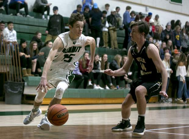 Summit High School senior guard Brendan Collins dribbles the ball against Battle Mountain High Sool during the Tigers' 72-50 home loss on Friday, Feb. 1, in Breckenridge.