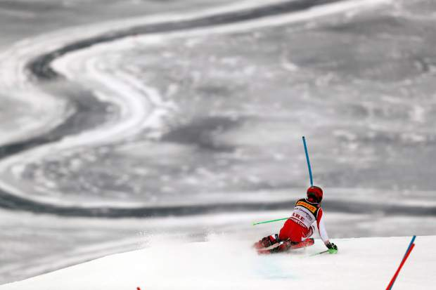 Austria's Marcel Hirscher speeds down the course on his way to win the men's slalom, at the alpine ski World Championships in Are, Sweden, Sunday, Feb. 17, 2019. (AP Photo/Gabriele Facciotti)