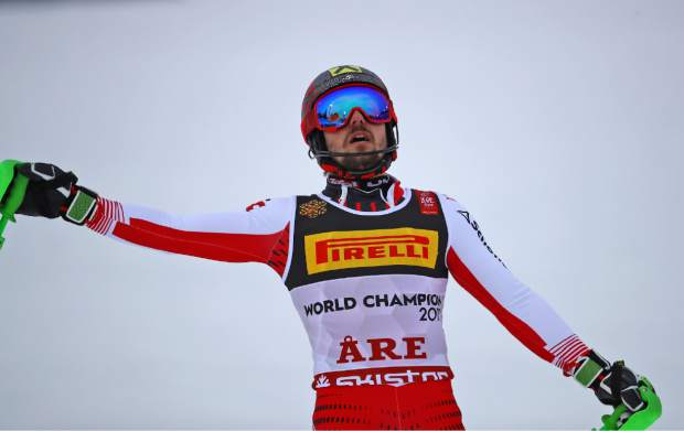 Austria's Marcel Hirscher celebrates winning the men's slalom, at the alpine ski World Championships in Are, Sweden, Sunday, Feb. 17, 2019. (AP Photo/Marco Trovati)